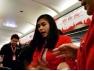 两中国情侣游客飞机上侮辱泰国空姐被抓
